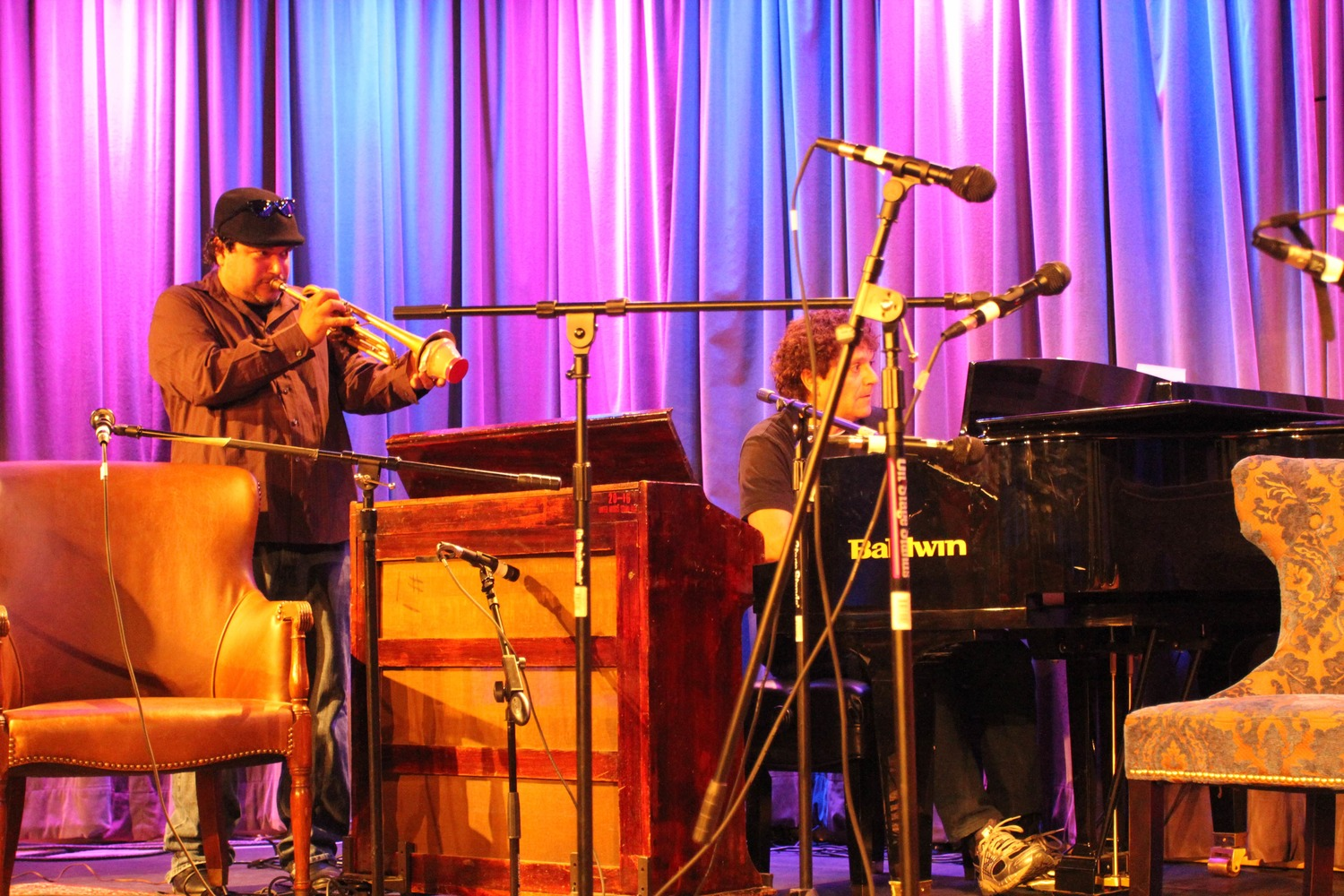 from left to right, performing duo Asdru Sierra of Ozomatli (vocals and trumpet) and Anthony Marinelli (piano and celeste) playing traditional Mexican songs at the Grammy Museum, Hollywood, CA, 2012