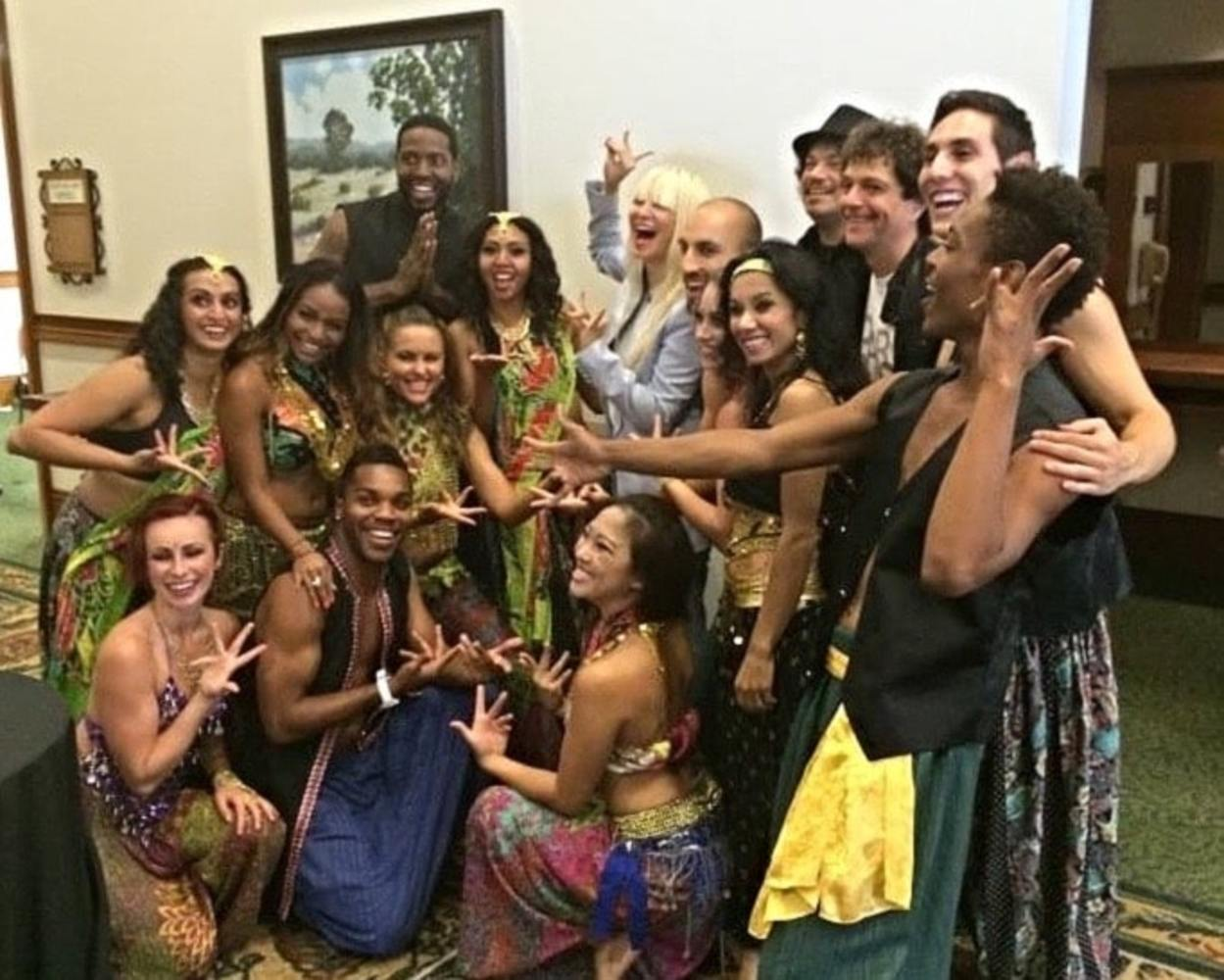 Singer/songwriter Sia (center) with BollyDoll creators Amrita Sen and Anthony Marinelli and cast, after their performances at Deepak Chopra's Sages & Scientists Symposium, Carlsbad, CA (2014)