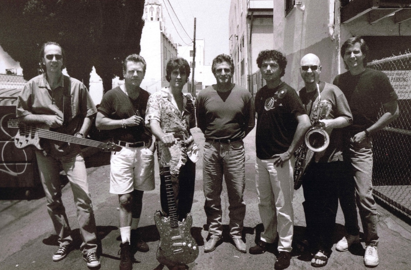 "L to R Fer Bos, John ""Juke"" Logan, Russ Parrish, John Herzfeld, Anthony Marinelli, Brandon Fields and Mark Curry (engineer) behind Anthony's studio, Hollywood, CA, 1997"