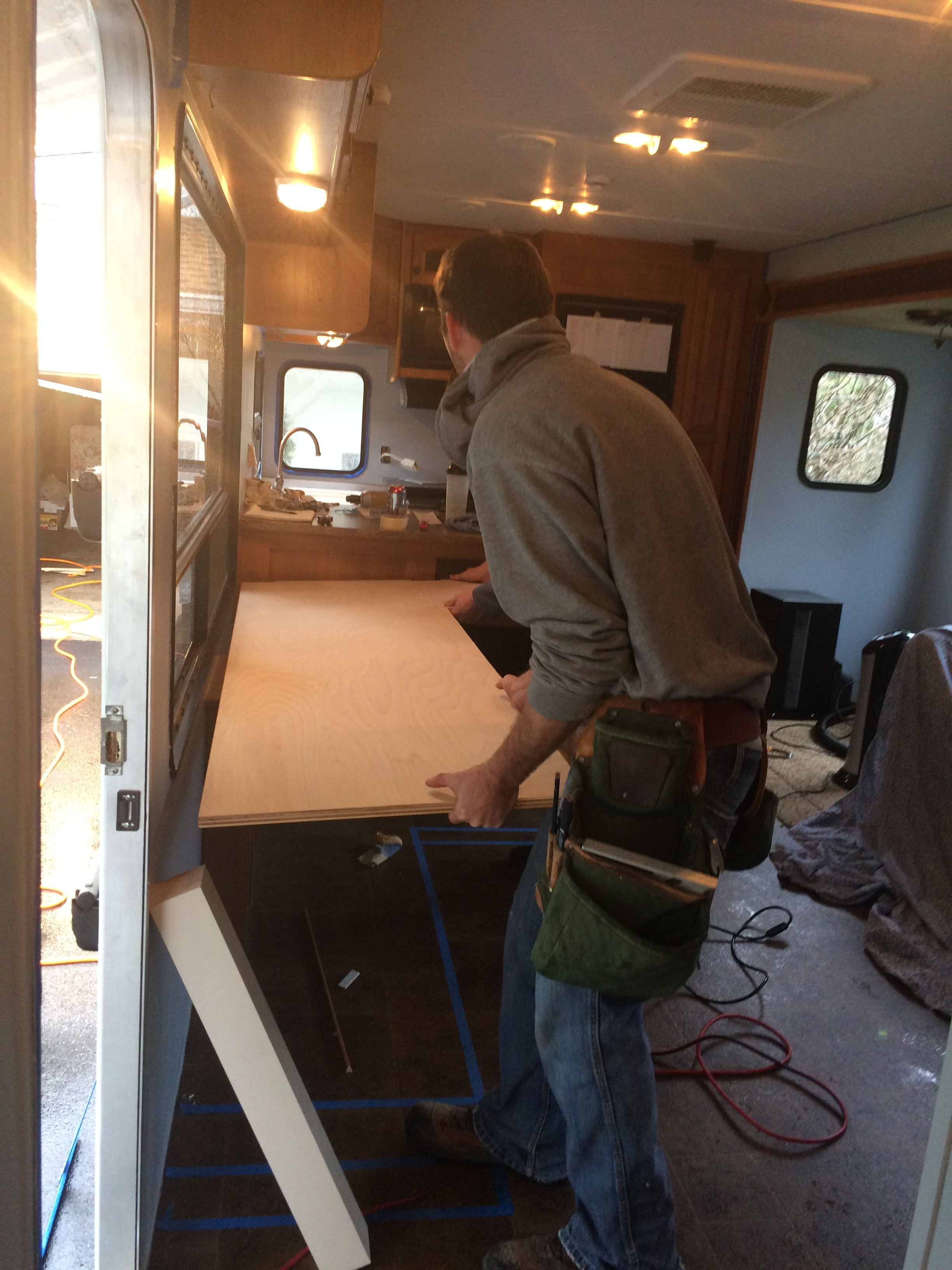 Friend and trailer savior, Greg, helps install the desk