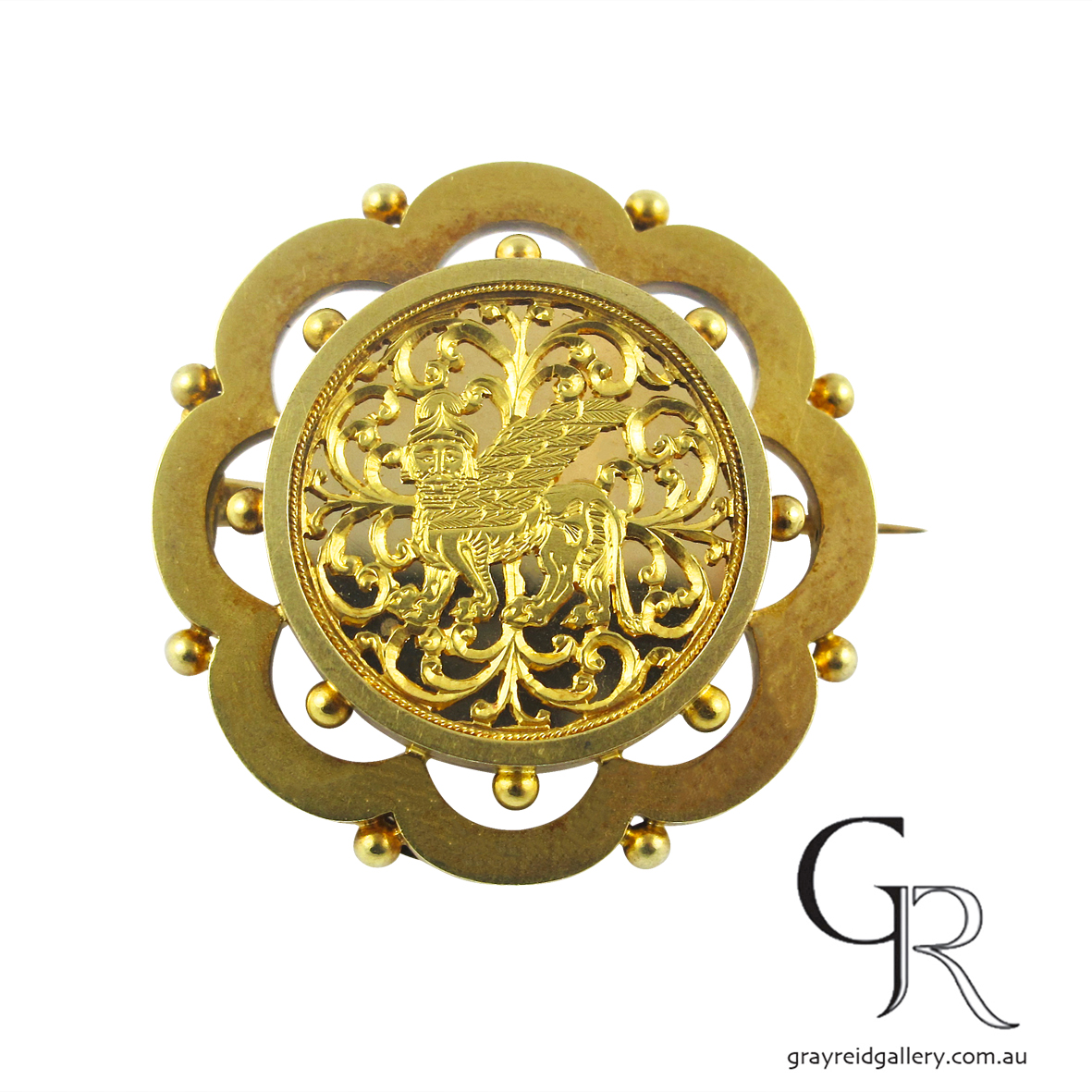 assyrian revival brooch melbourne gray reid gallery yellow gold.jpg