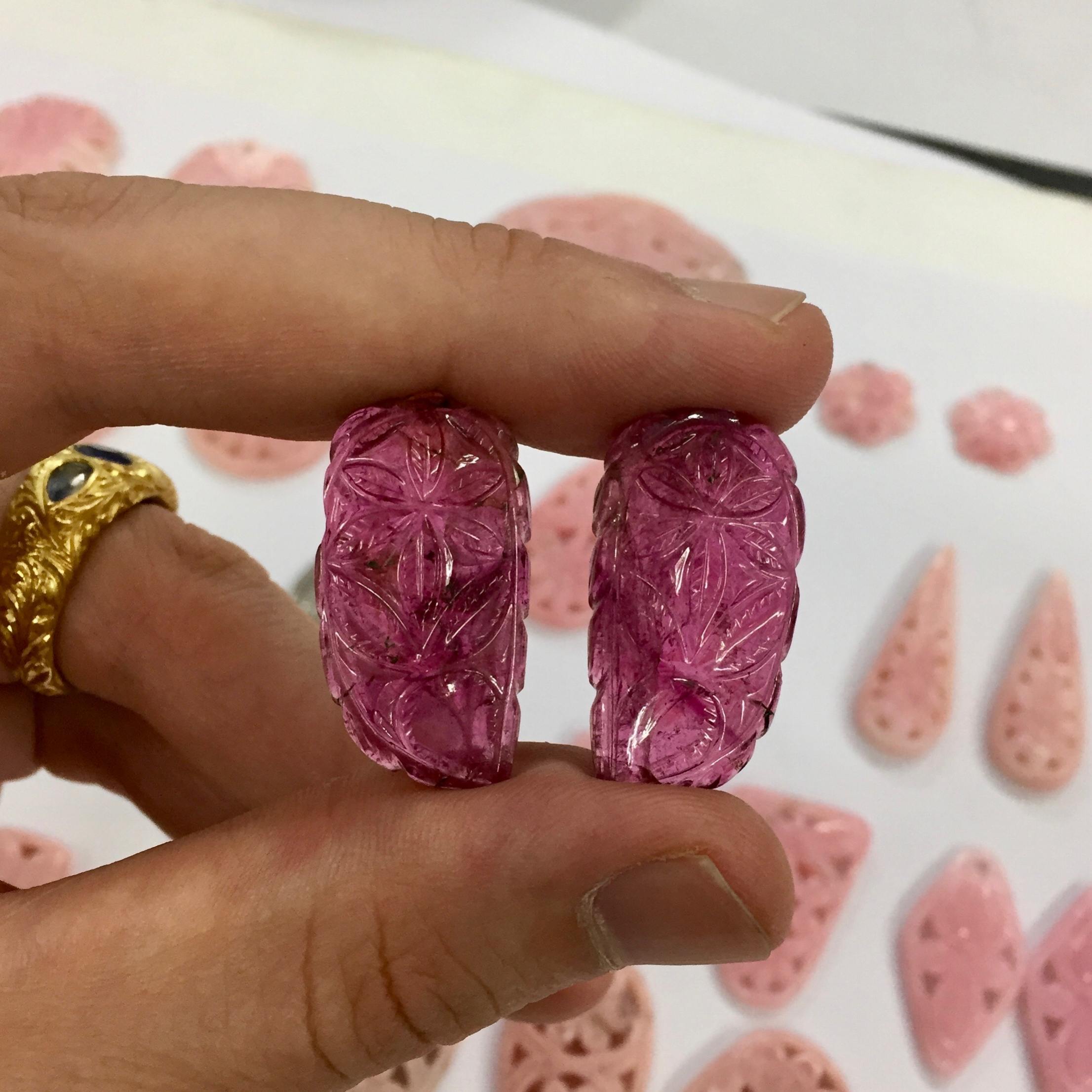 Pair of Carved Pink Tourmalines. The perfect pair of gems for an individual style.