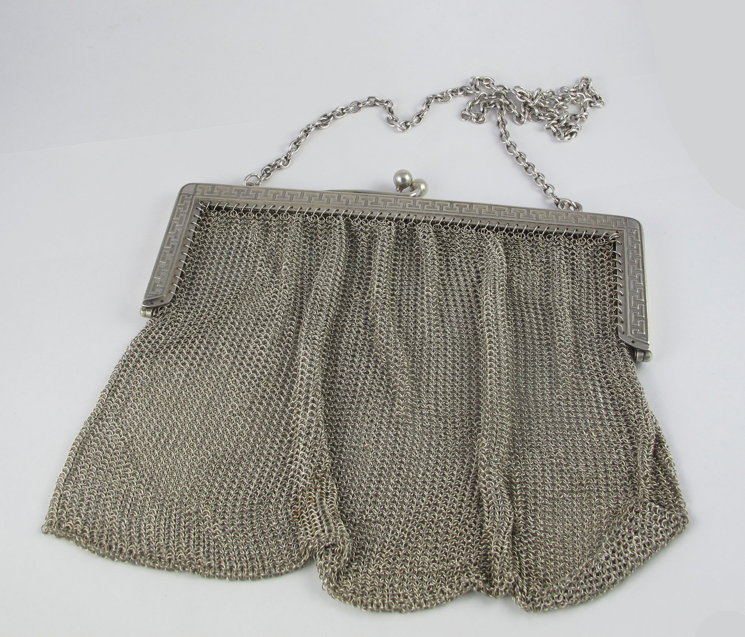 And here is that same bag after a full clean and restoration by our gold and silversmiths