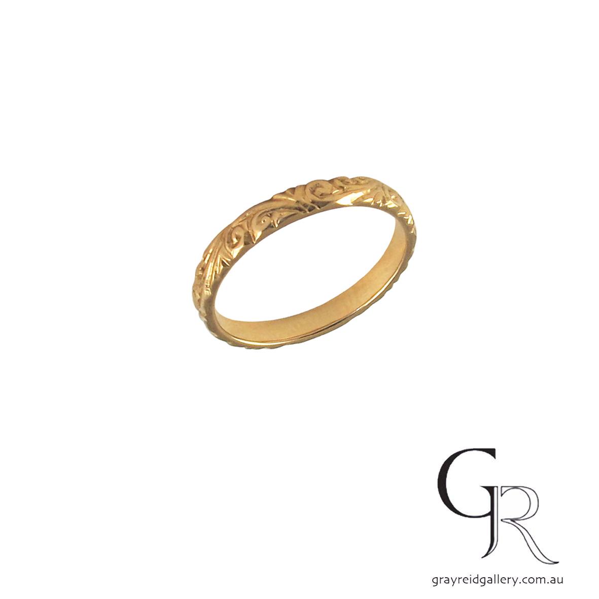 Custom made carved rose gold wedding band.jpg