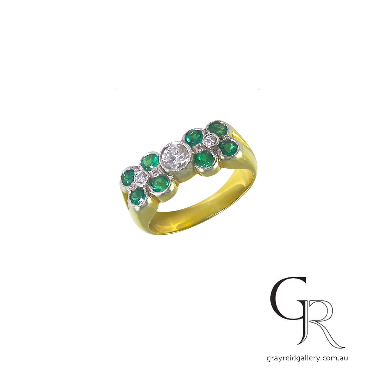 emerald and diamond ring in yellow gold.jpg