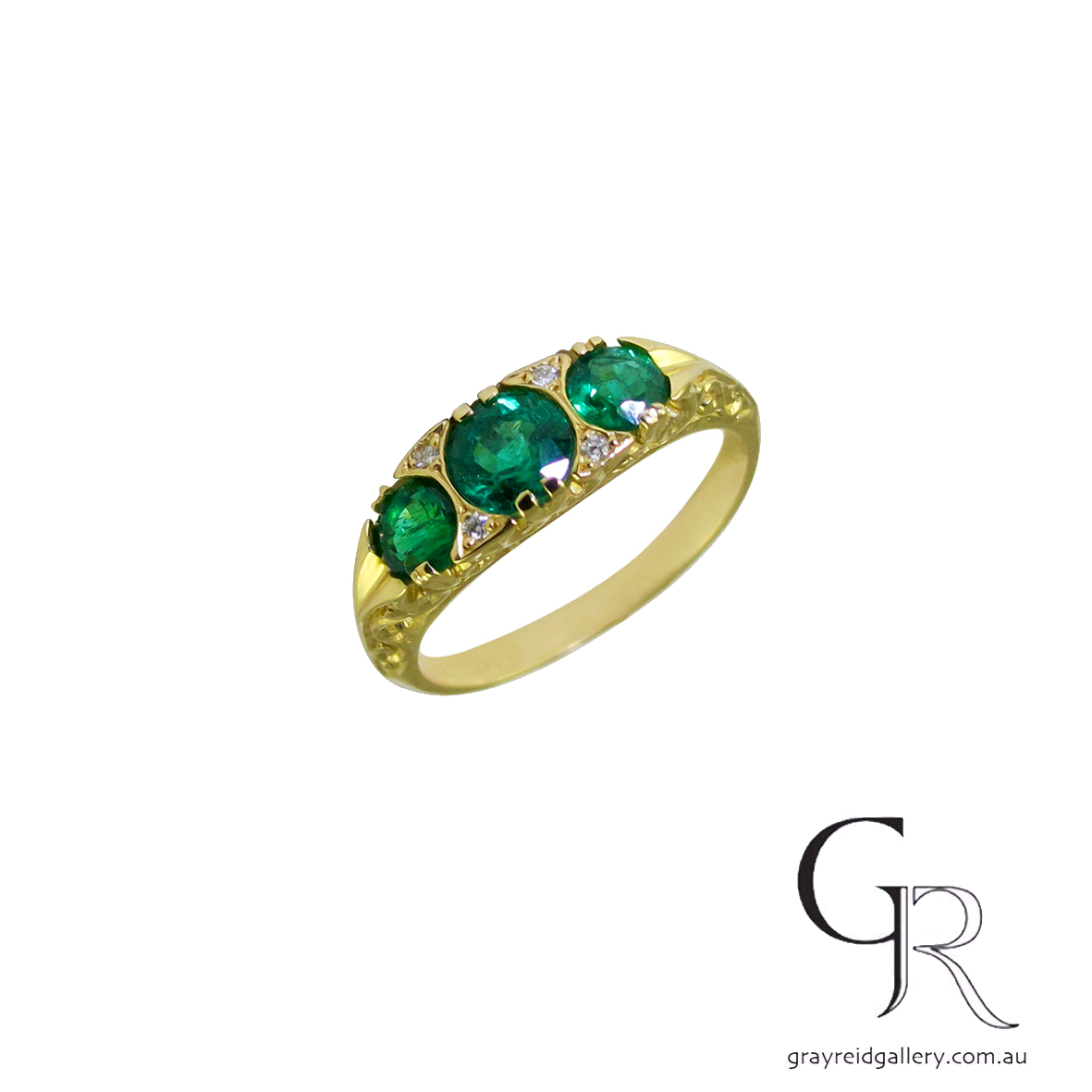 3 Stone Emerald Engagement Ring
