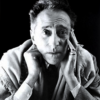 Jean Cocteau wearing Trios Ors rings (photo Credit Cartier Archive)