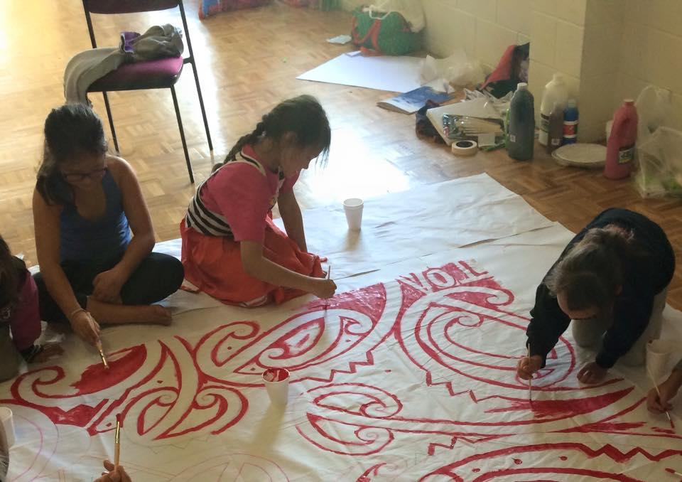 Guiding  tamariki  at my marae to paint their own mural.