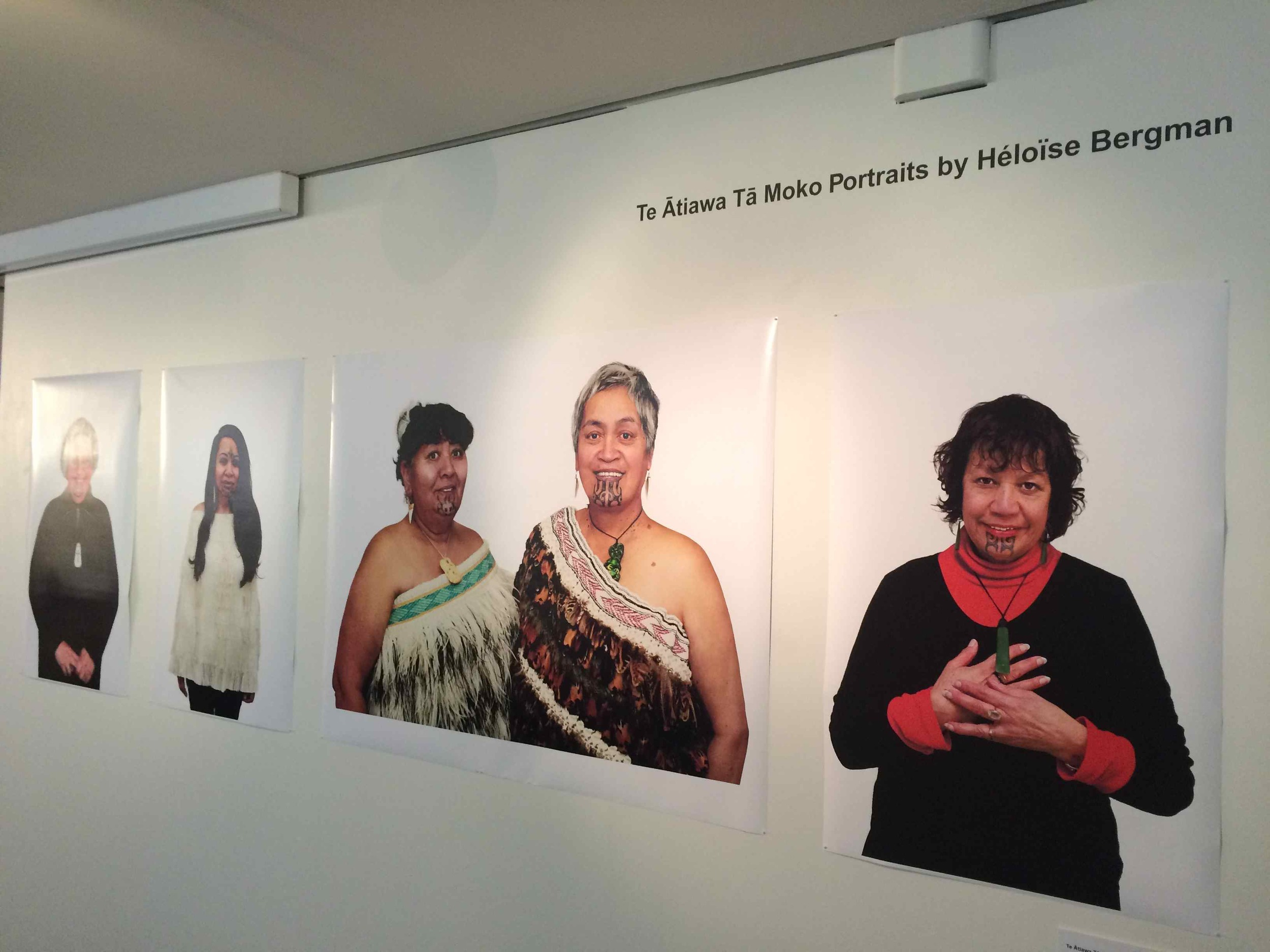 Photographic portraits in the exhibition featuring Te Ātiawa women and their moko kauae, by Heloise Bergman.