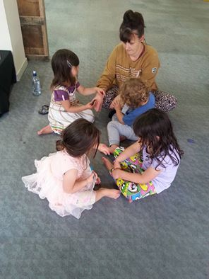 Founding member Sian Montgomery-Neutze and some of our tamariki practicing their kirituhi skills at the space.