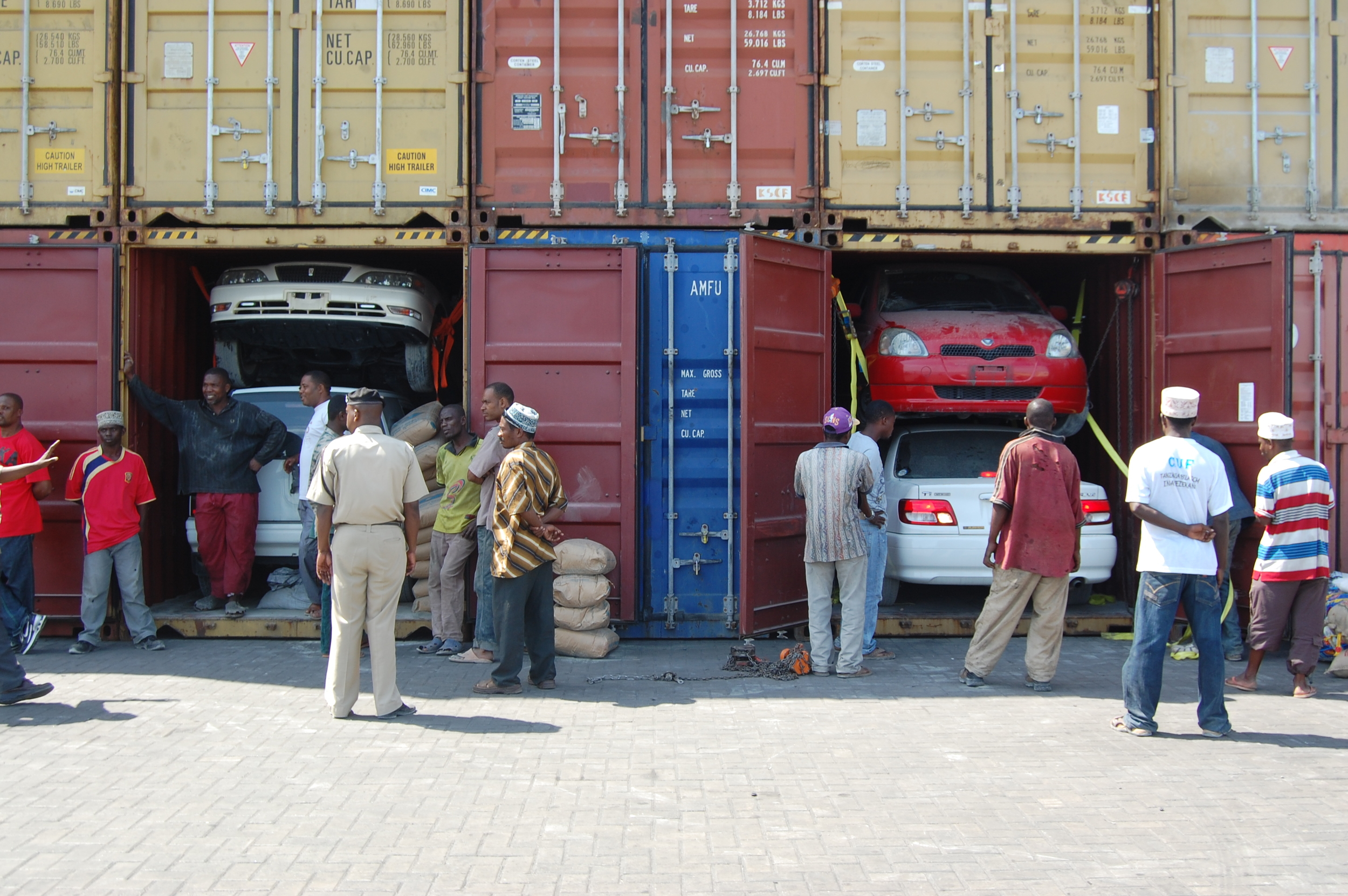 Inspecting second-hand cars in the port of Dar es Salaam. Source: TICTS.