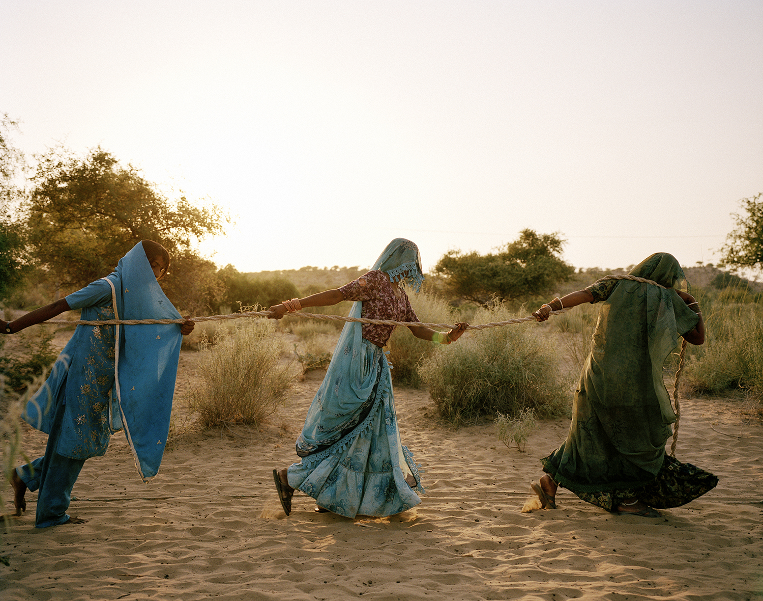Women pull water from a well. Tharpakar, Pakistan, 2013.