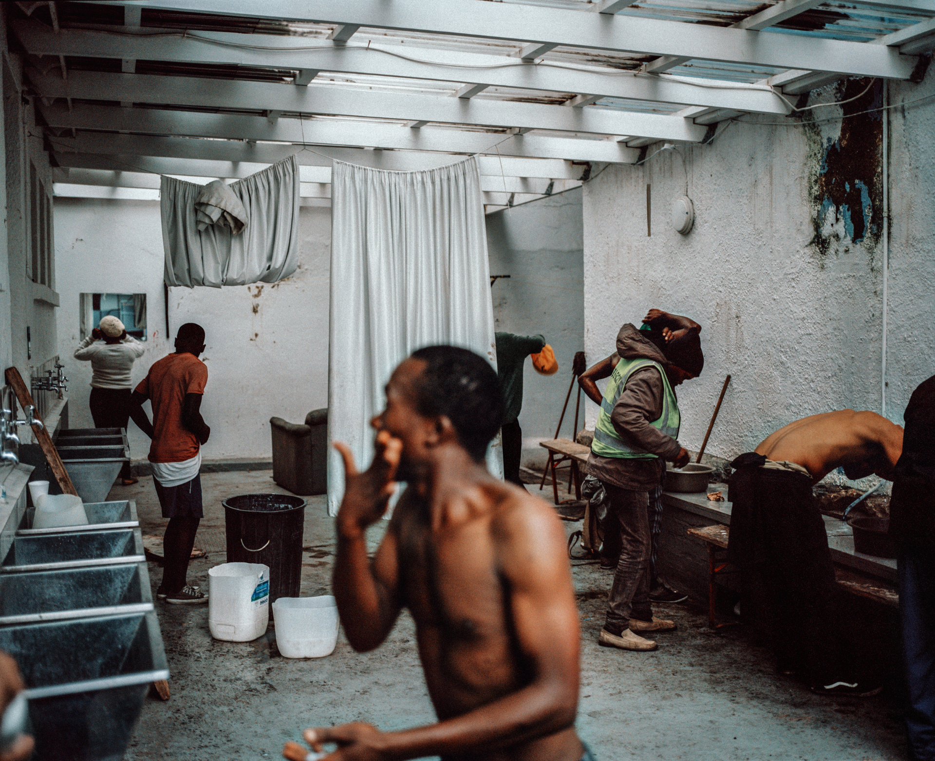Bathing area for the homeless due to drought restrictions closing down public restrooms. The Carpenter's Shop, Cape Town, South Africa, 2018.