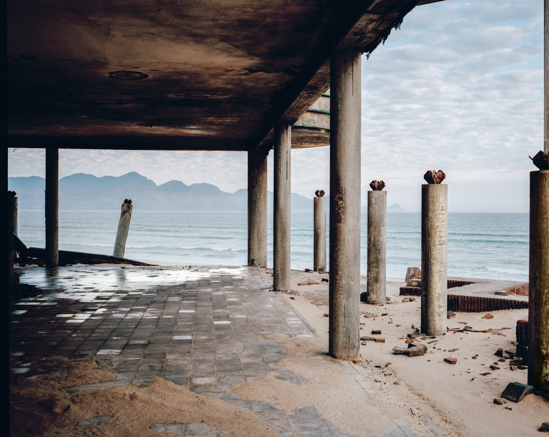 Macassar Beach Pavillon on False Bay. Abandoned water park due to mismanagement now reclaimed by dunes. Cape Town, South Africa, 2018.