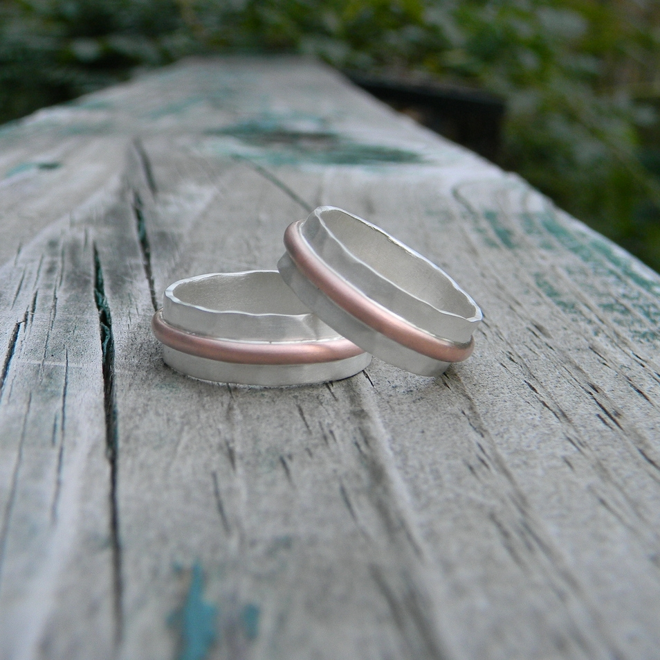 Textured sterling silver bands with 14k rose gold center band.  Matte finish
