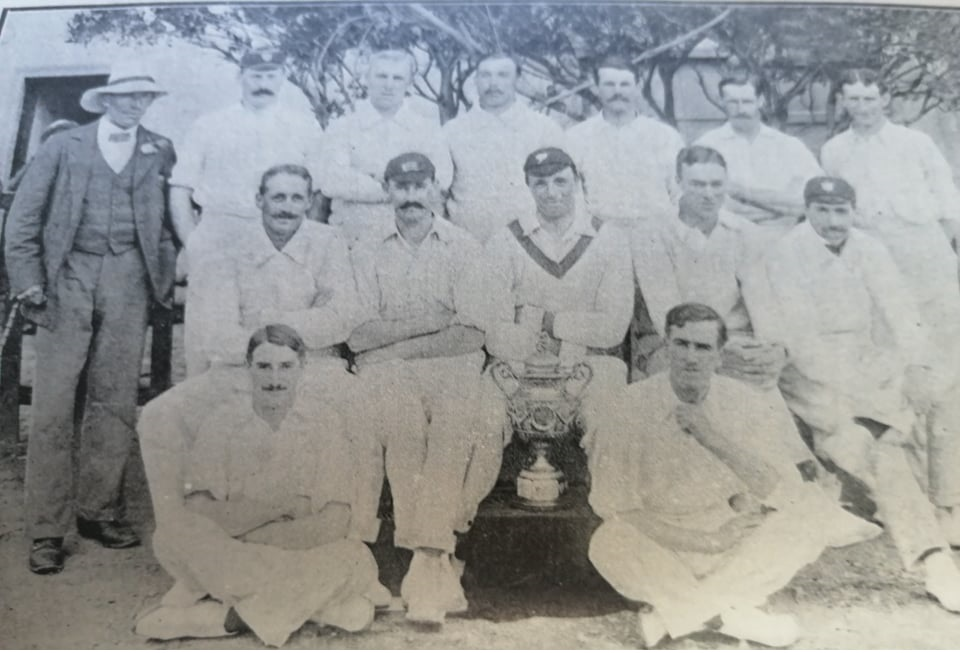 The Transvaal side of 1903. Reggie Schwarz seated second from left in the middle row. Gordon White first from right in the second row. Aubrey Faulkner in the front row on the left.