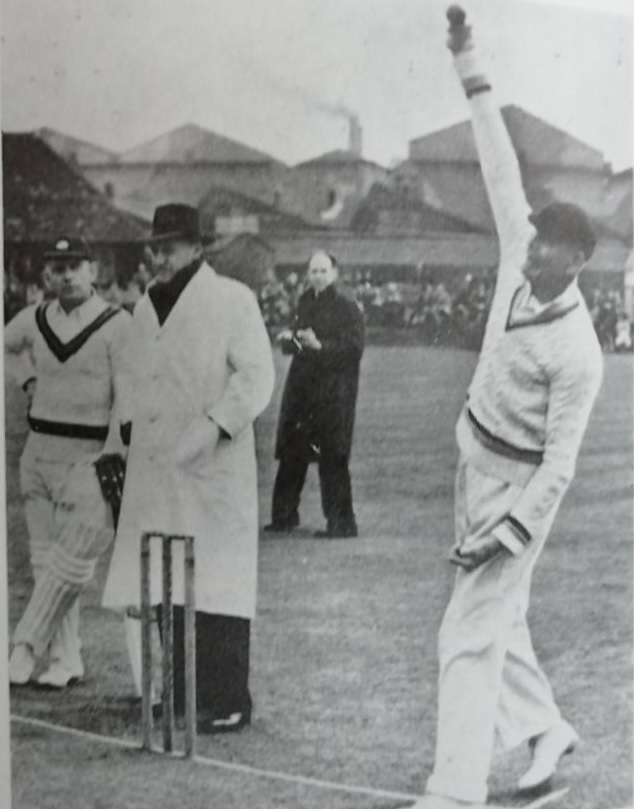 Frank Chester officiates at Stafford in 1953. It is the testimonial match of SF Barnes, 80, who is still active as a bowler. The batsman at the non-striker's end is Cyril Washbrook