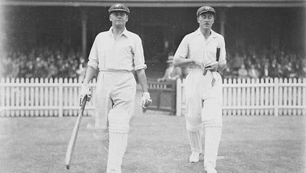 Bill Woodfull (left) and Vic Richardson walking out to open the batting in the final Bodyline Test. Photo courtesy: Wikimedia Commons.
