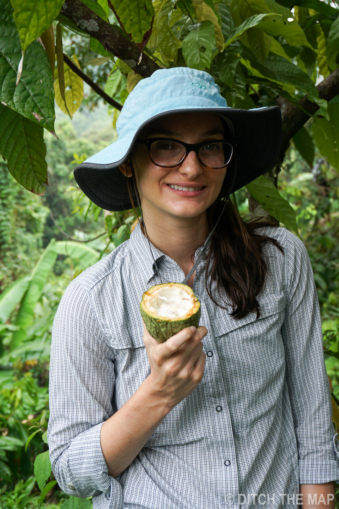 Sylvie holding a cocoa seed