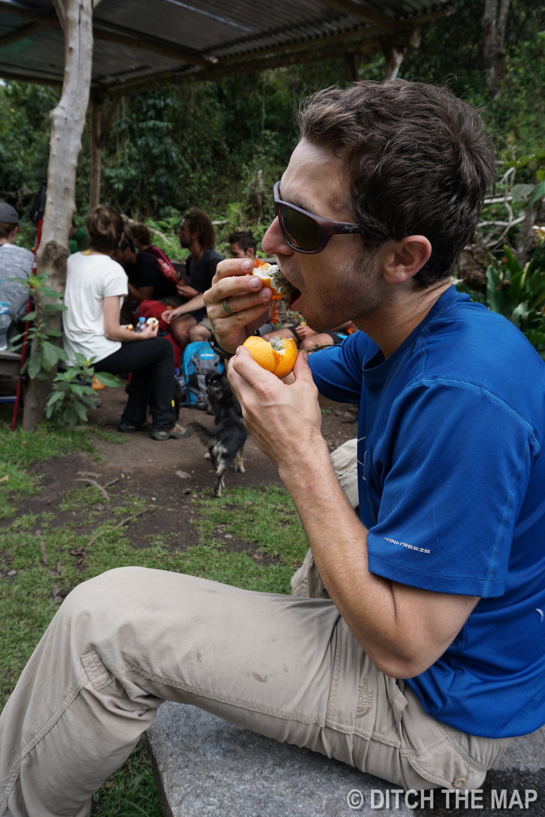 Scott eating passionfruit during the hike