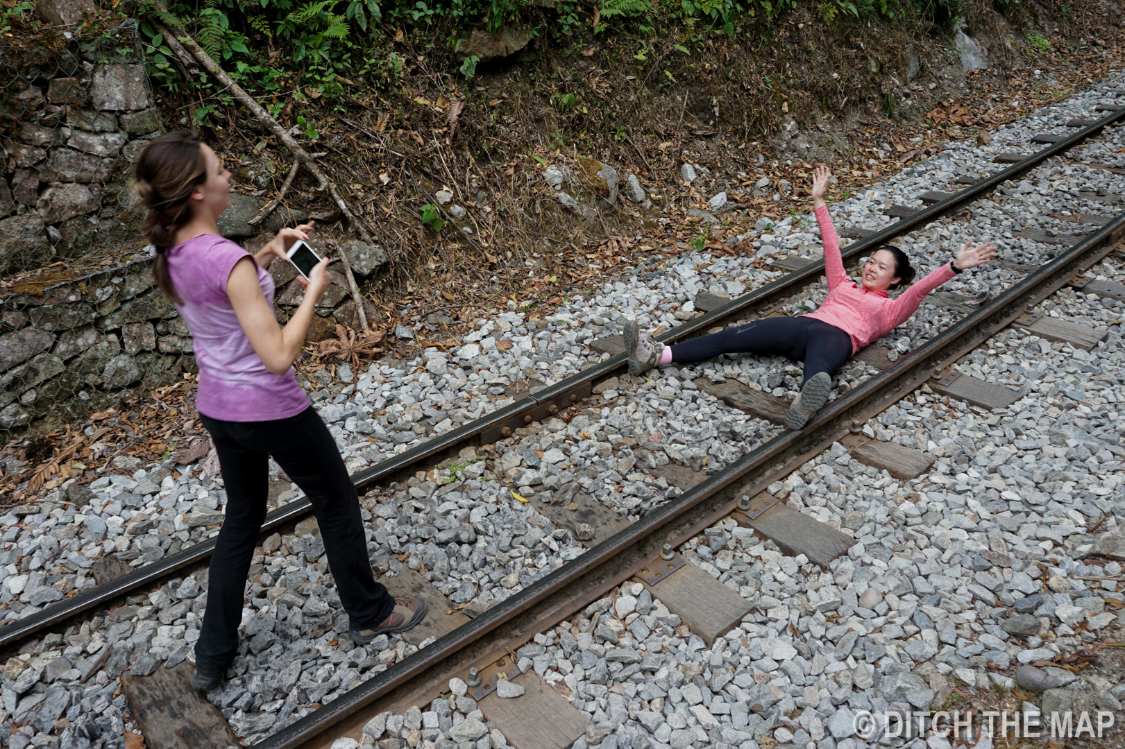 Angelica and Carmen play on the train tracks during our last 10km stretch to Aguas Calientes