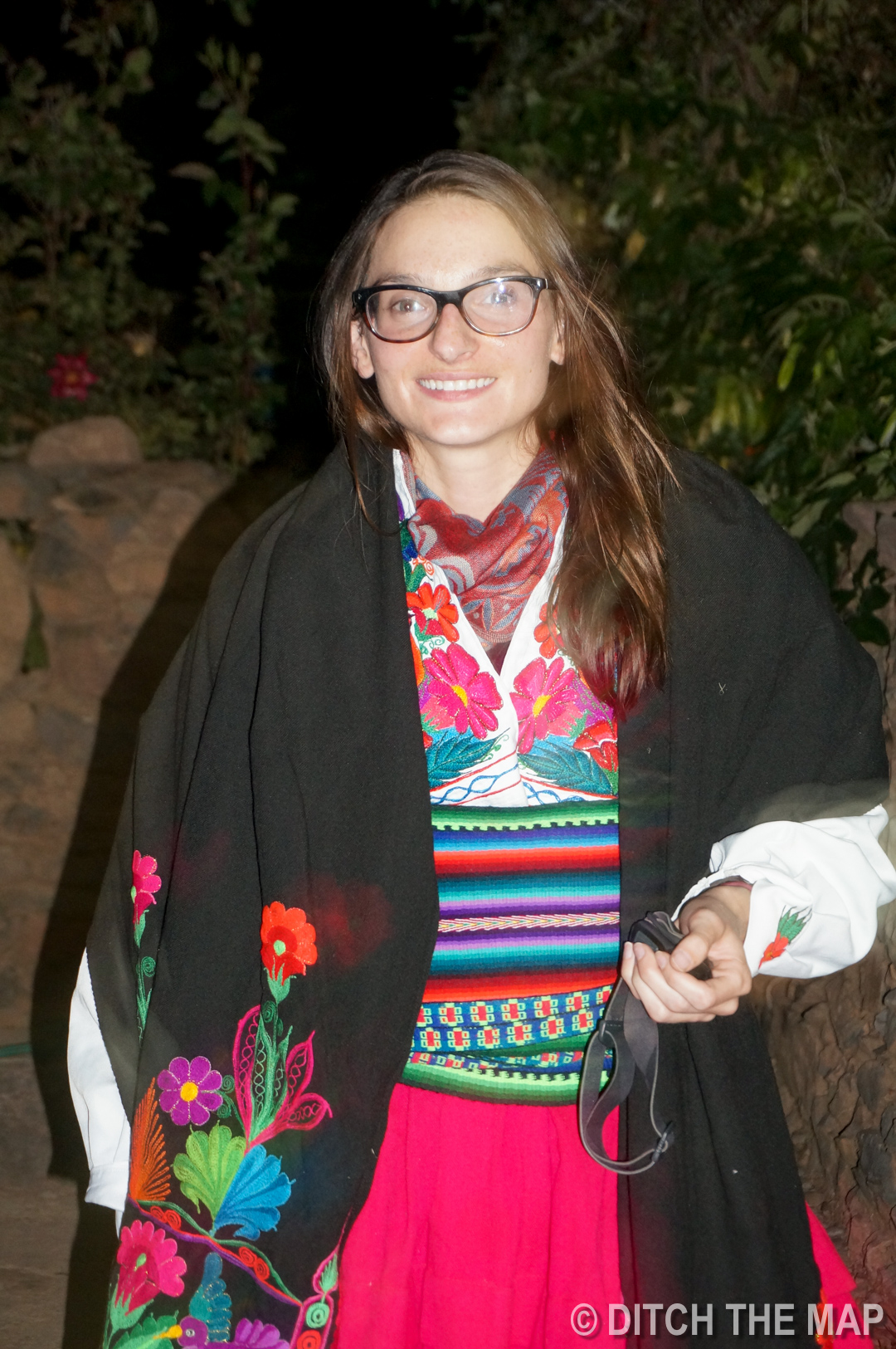 Sylvie dresses up in the local garb on Amantani island in Lake Titicaca, Peru