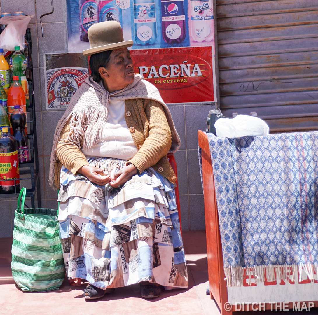 """Indigenous Woman wearing traditional """"silly"""" hat in La Paz, Bolivia"""
