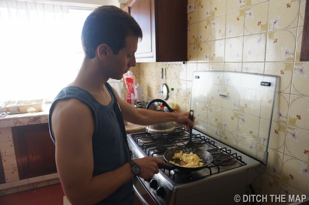 I cook breakfast for Sylvie in our hotel in La Paz, Bolivia