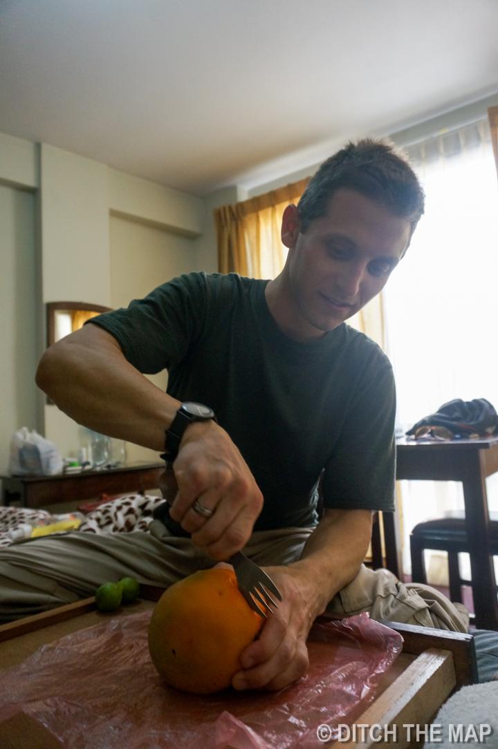I prepare a mango for Sylvie and me in La Paz, Bolivia