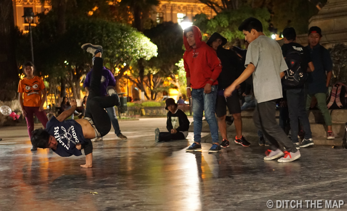 Breakdancers in the center square in Sucre, Bolivia
