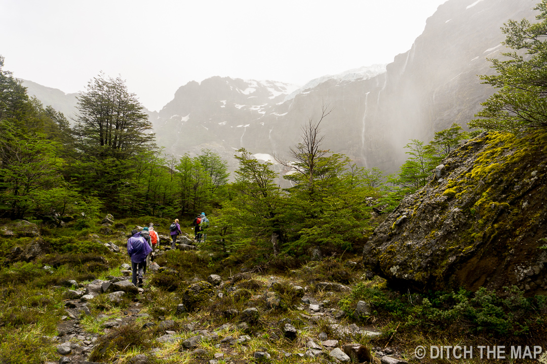 Walking the last stretch of our hike through windy conditions to Alerce Glacier outside Bariloche, Argentina