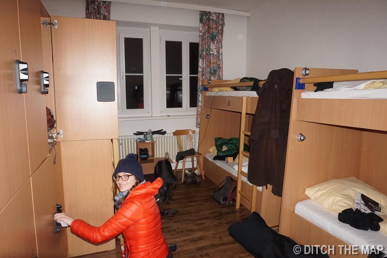 Sylvie locking her bags up at our hostel in Salzburg, Austria