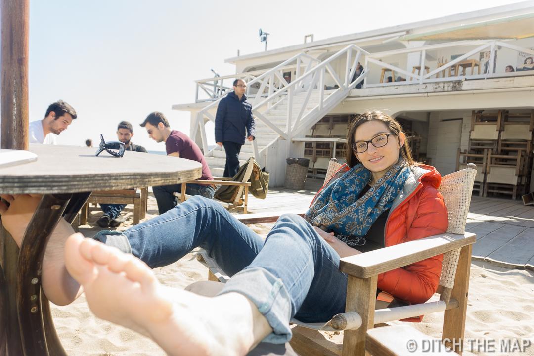 Sylvie enjoys a free foot rub on the Black Sea in Varna, Bulgaria