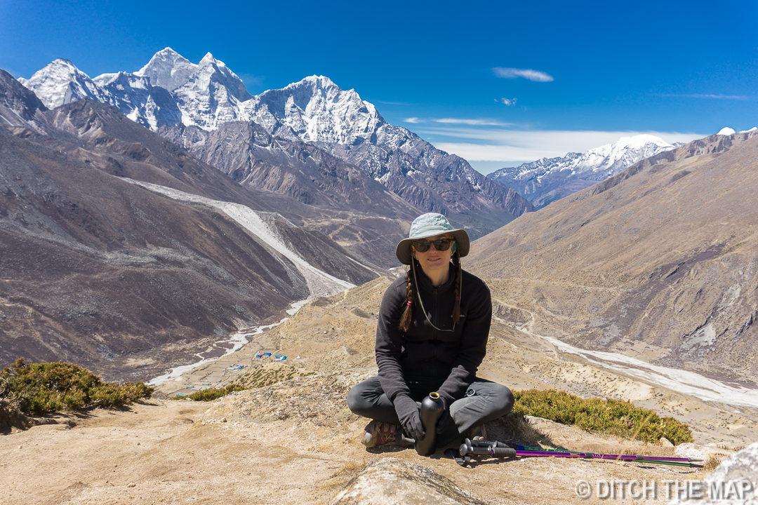 Sylvie rests while hiking up Nagarjun Hill outside of Dingboche