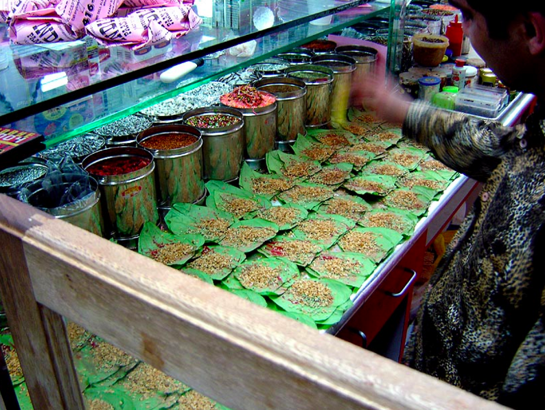 Shopkeep Making Paan at Stall on Street