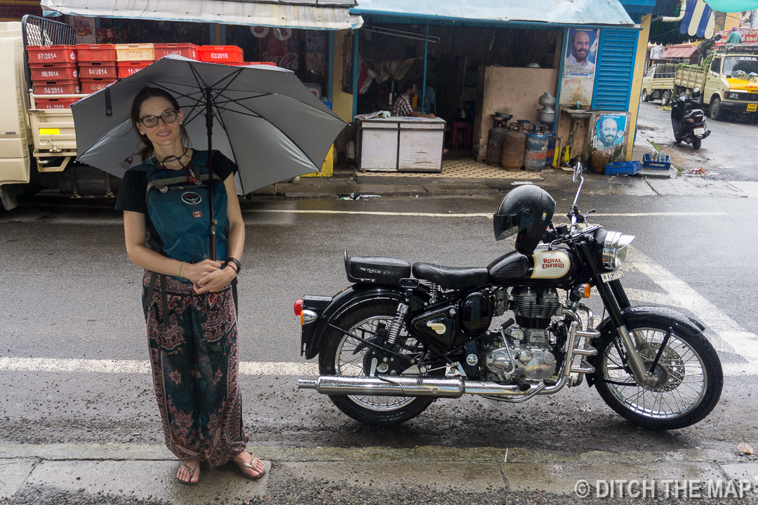 Sylvie by a parked motorcycle in Kochi, India
