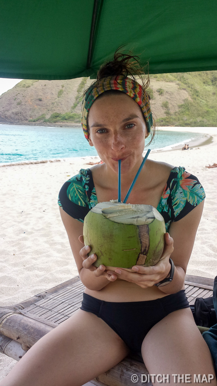 Sylvie Drinking a Fresh Coconut at Mawun Beach in Lombok, Indonesia