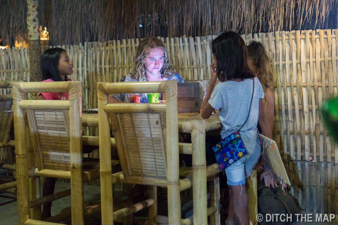 Kids Selling Jewelry at Dinner in Kuta, Lombok