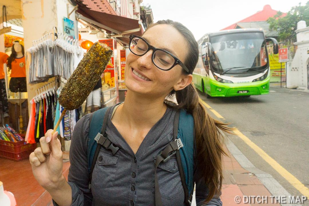 Enjoying Corn Streetside in Malacca, Malaysia