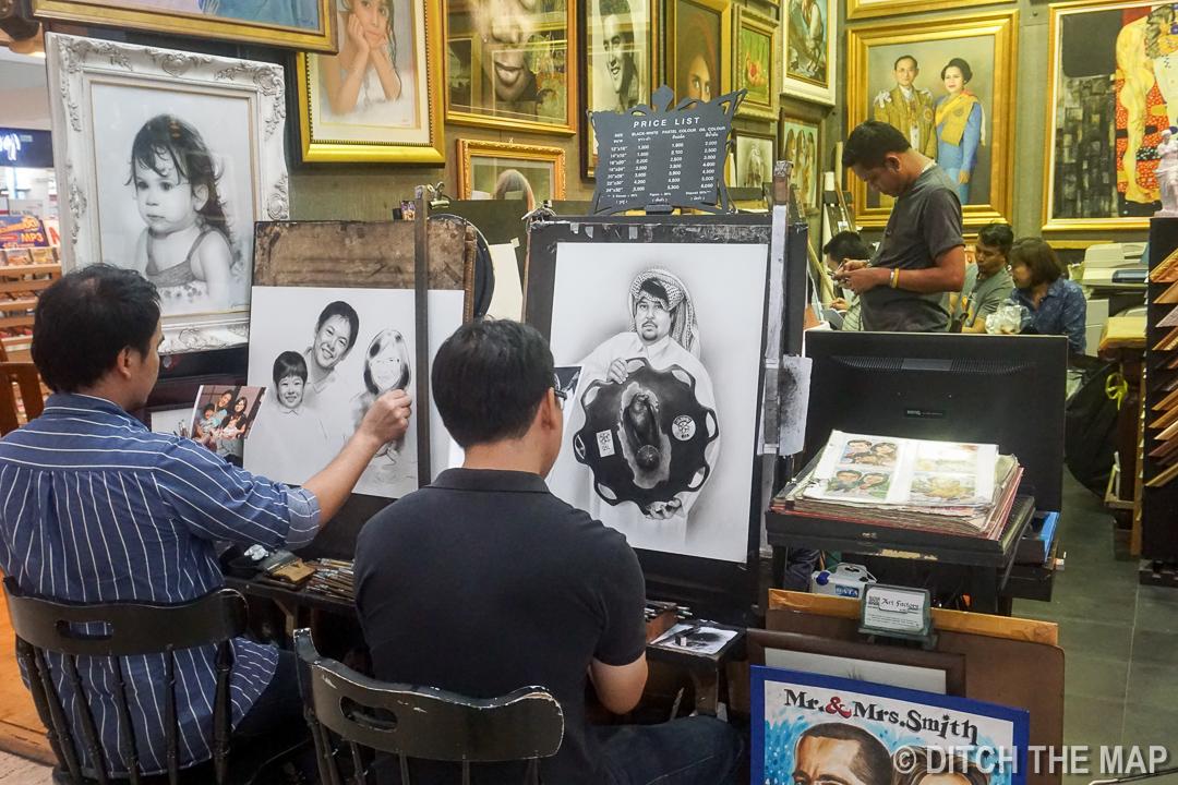 Men Drawing at MBK in Bangkok, Thailand