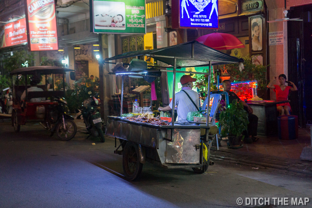 Guy Selling Skewers on the Street in Phnom Penh, Cambodia
