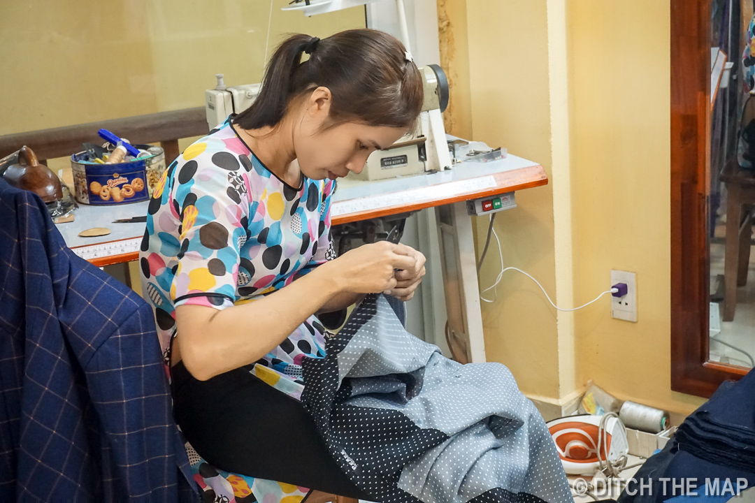 Su, Our Tailor, Making Last Minute Alterations