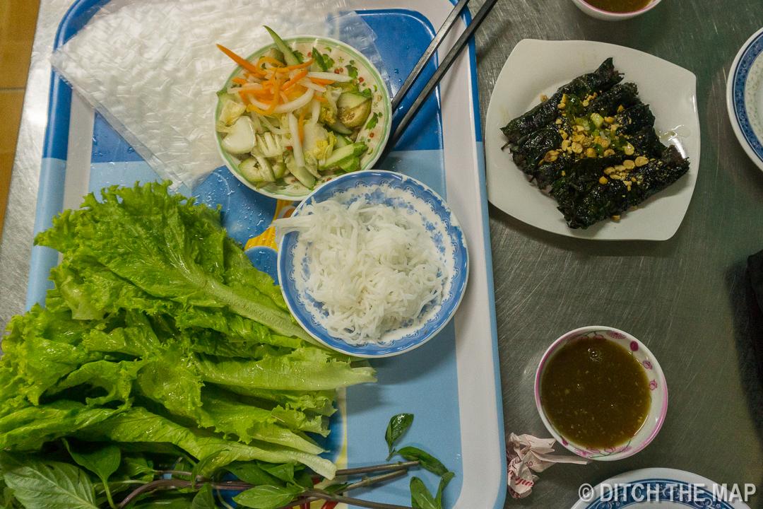 Eating Bo La Lot from a Street Side Restaurant in HCMD, Vietnam