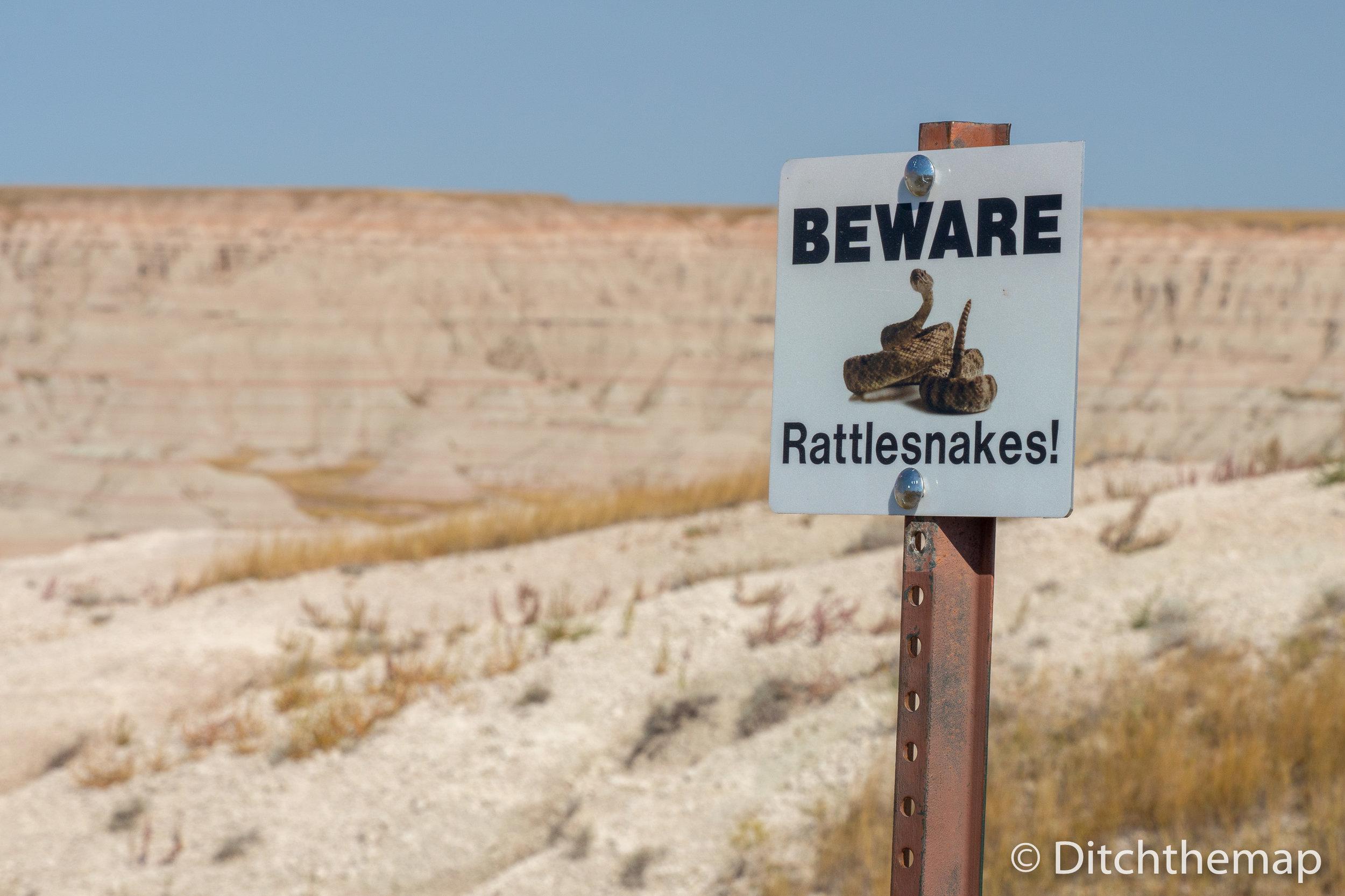 Beware of Rattlesnakes signpost in the Badlands South, Dakota