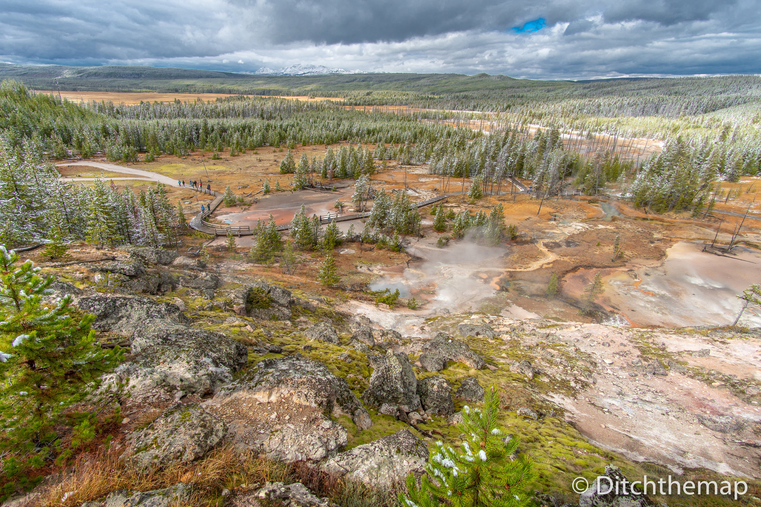 Yellowstone landscape of geiser pools and mud pots