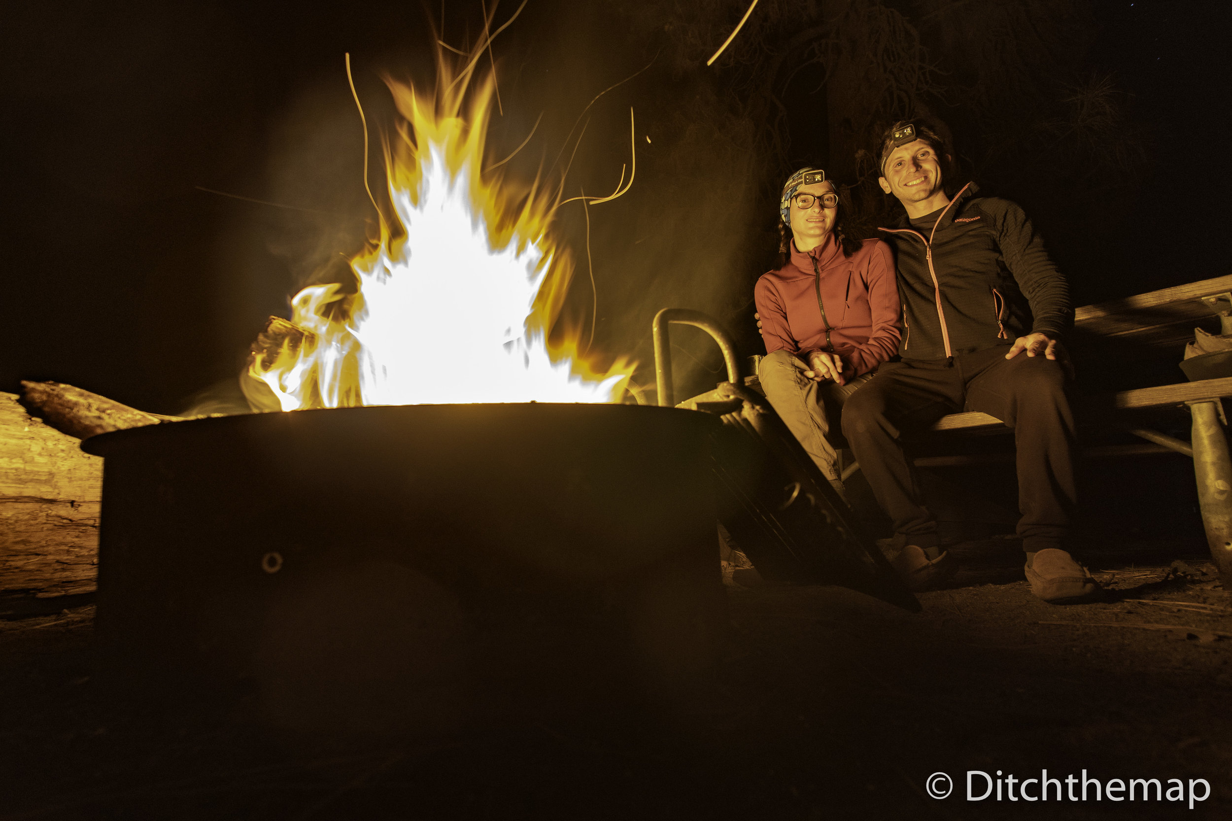 We stay warm by the fire in Yosemite National Park, California