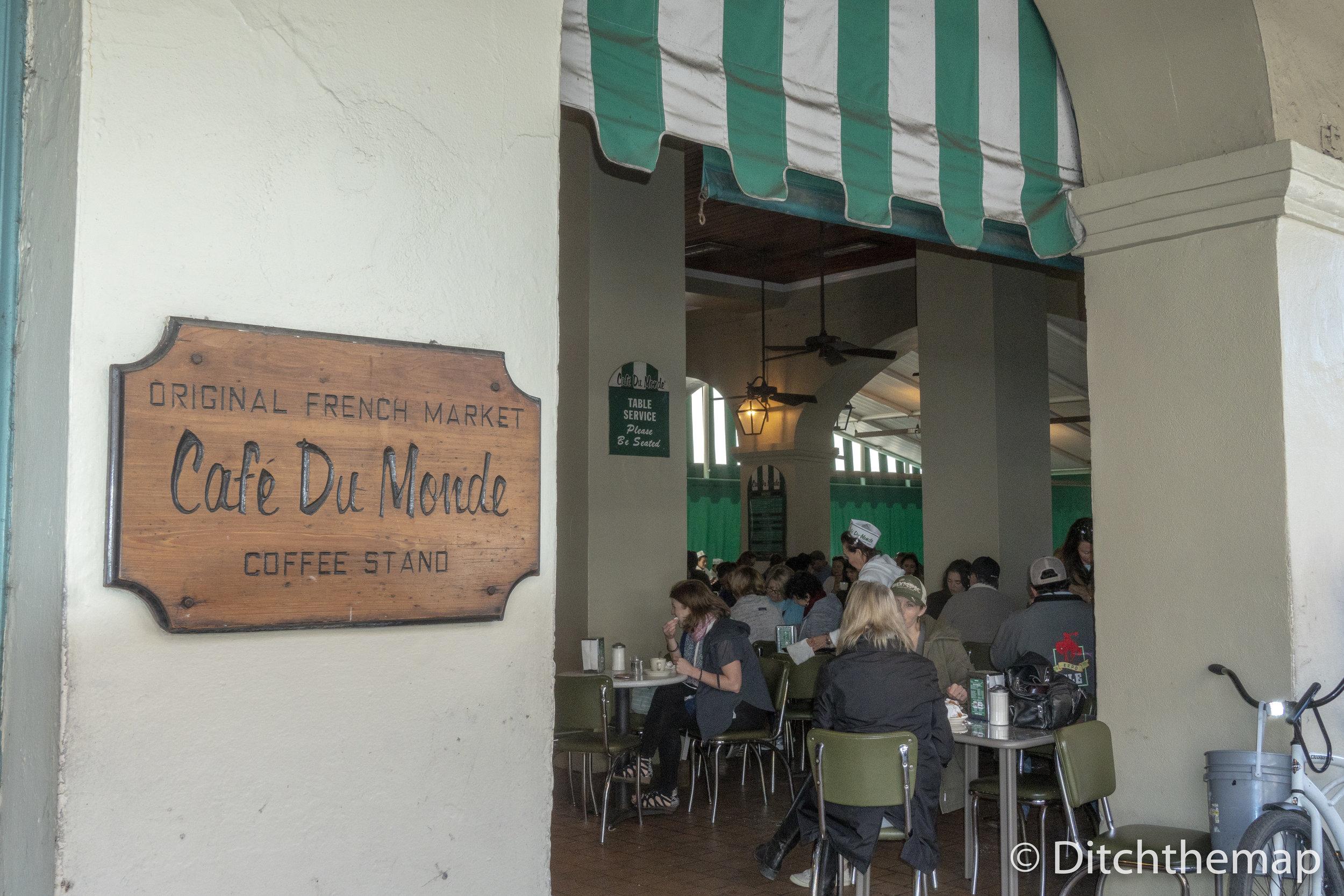 Enjoying Beignets and Cafe Au Lait
