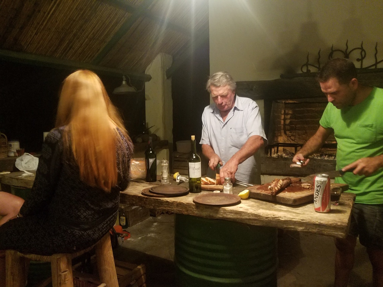 Men prepare the asado meal