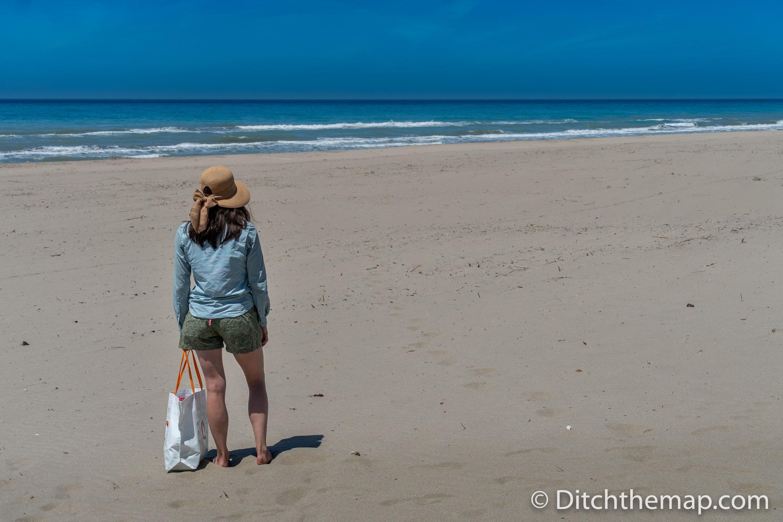 Girl Walking on sandy beach