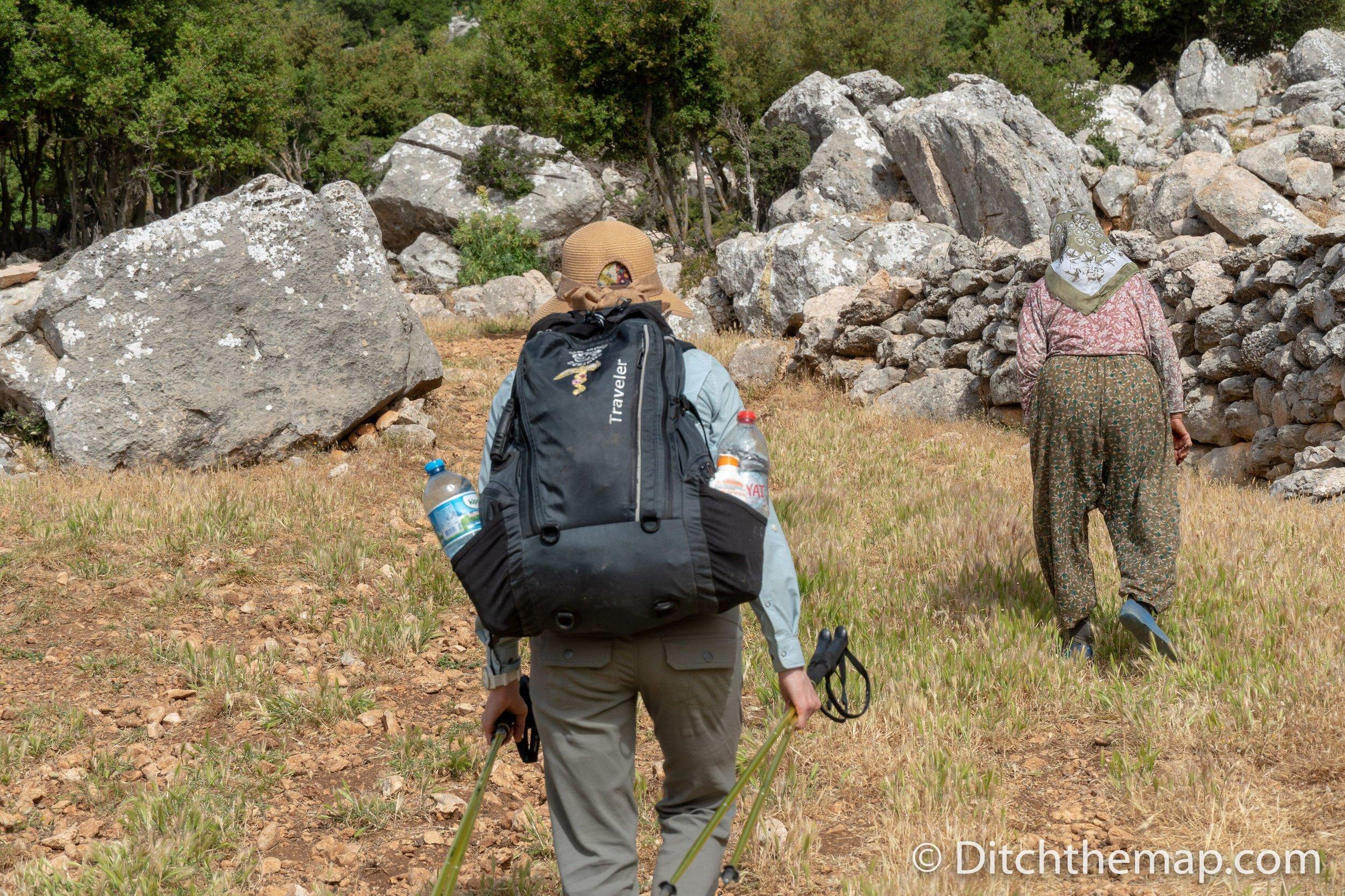 We follow a villager to her home along the Lycian Way between Saribelen and Gökçeören